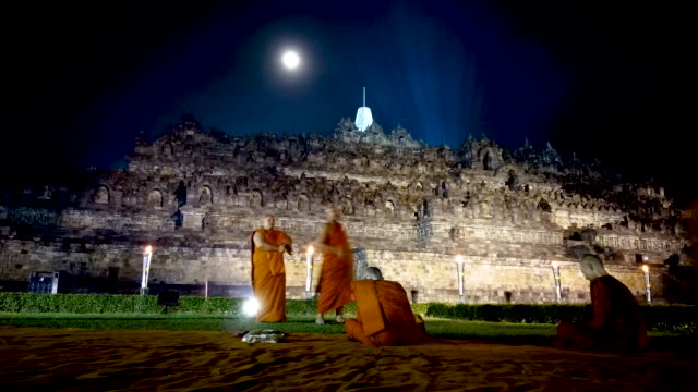 timelapse of borobudur temple during celebrations for vesak day on may 18 2019 in magelang central java indonesia - buddha's birthday stock videos and b-roll footage
