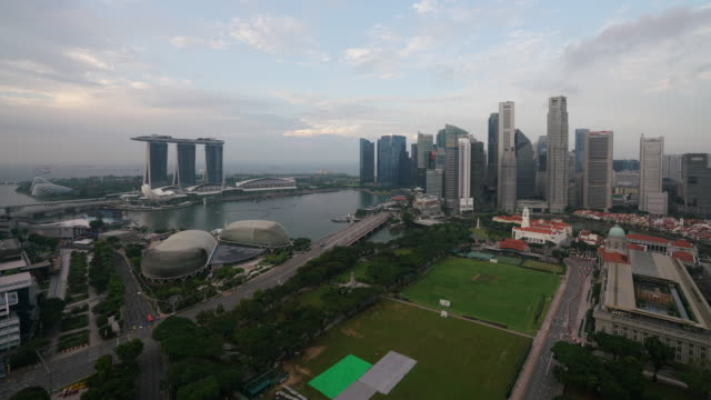 timelapse of business district of singapore city downtown at sunset - singapore stock videos & royalty-free footage