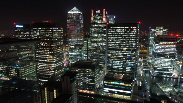 london: timelapse of canary wharf skyline from rooftop - canary wharf stock videos & royalty-free footage