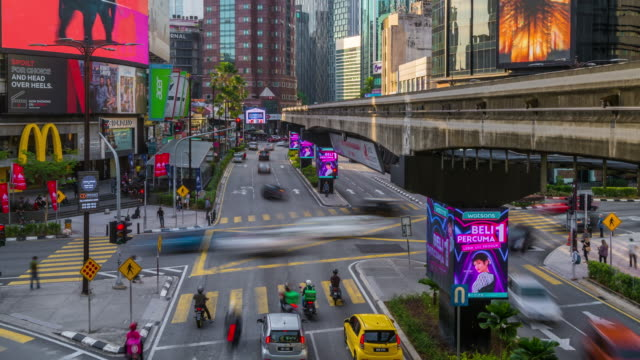 time-lapse of car moving at downtown district - kuala lumpur stock videos & royalty-free footage