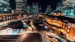 4K UHD time-lapse of car traffic at Tokyo Station at night with Japanese people crossing roads. Tokyo tourist attraction, Japan tourism, Asian city life, or Asia transportation concept