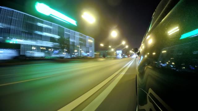 timelapse of car traffic on the roads of the night city - 光跡点の映像素材/bロール
