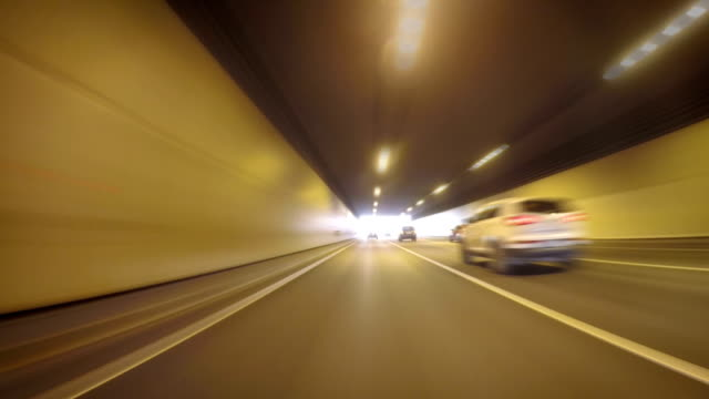 vidéos et rushes de timelapse of car traffic through the tunnel in dense urban traffic - long