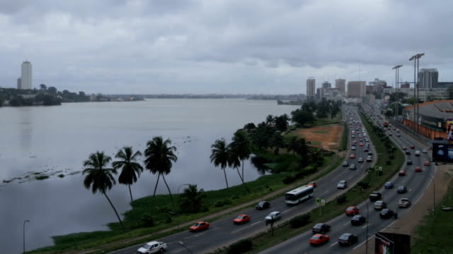 time-lapse of cars on highway and clouds on overcast day/ abidjan/ ivory coast - côte d'ivoire stock videos & royalty-free footage