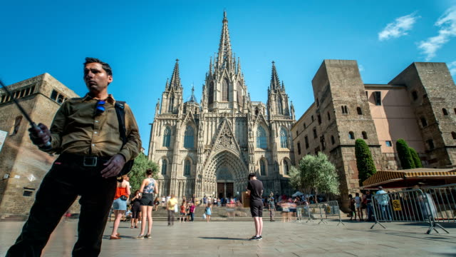 timelapse of cathedral of barcelona with visitors, and tourist visiting it - gothic quarter barcelona stock videos and b-roll footage