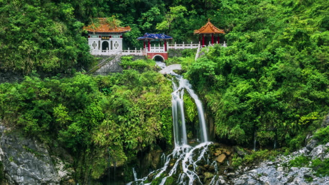 4k timelapse of changchun temple, eternal spring shrine and waterfall at taroko national park - taiwan stock videos & royalty-free footage