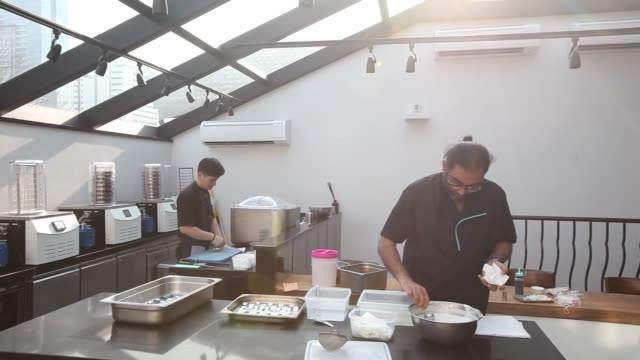 timelapse of chef gaggan anand preparing 'yogurt explosion' in the research and development kitchen at gaggan restaurant in bangkok thailand on... - molecular gastronomy stock videos & royalty-free footage