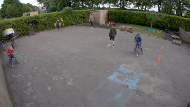 timelapse of children in school playground of school that has remained open during coronavirus lockdown for certain pupils - playground stock videos & royalty-free footage