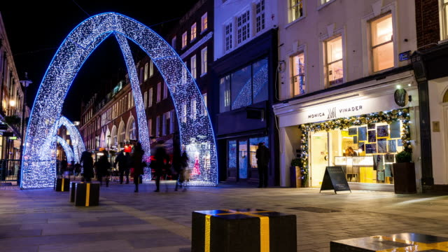 LONDON - CIRCA 2012: Timelapse of christmas decoration at South molton Street in London circa 2012