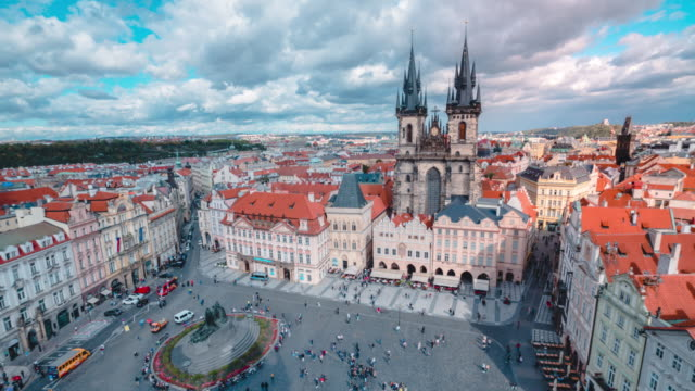 timelapse of church of our lady before týn in old town hall tower in prague - prague old town square stock videos & royalty-free footage