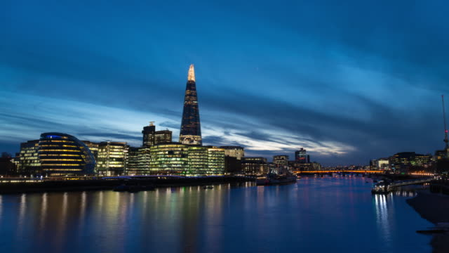 london: timelapse of city hall and the shard at night - gla building stock videos & royalty-free footage