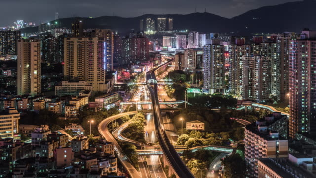 vídeos de stock, filmes e b-roll de t/l ws timelapse of city traffic /shenzhen,china - inclinando se