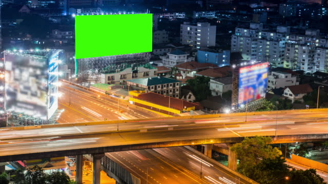 time-lapse of cityscape in bangkok city with chroma key green screen technology - billboard stock videos & royalty-free footage