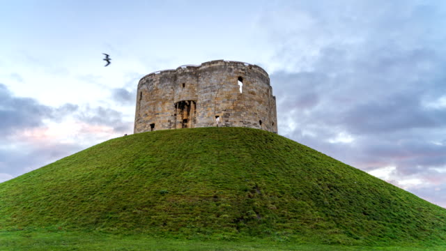 timelapse of clifford's tower in york, england, uk | english heritage - yorkshire england stock videos & royalty-free footage