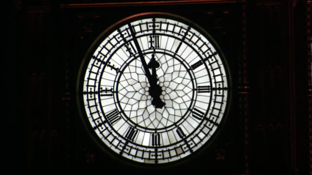 timelapse of clock striking midnight - clock tower stock videos & royalty-free footage