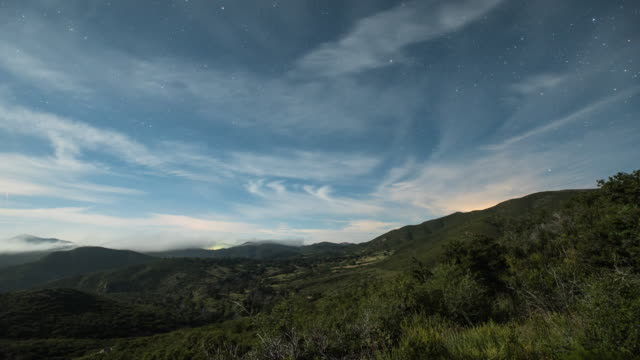 time-lapse of cloud waterfalls during night from mt laguna, shot on sony a7s, camera panning right. - pacific crest trail stock videos & royalty-free footage