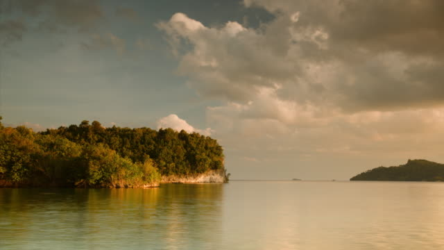 time-lapse of clouds against beautiful tropical headland - papua stock videos and b-roll footage