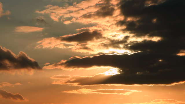 Timelapse of clouds at sunset.