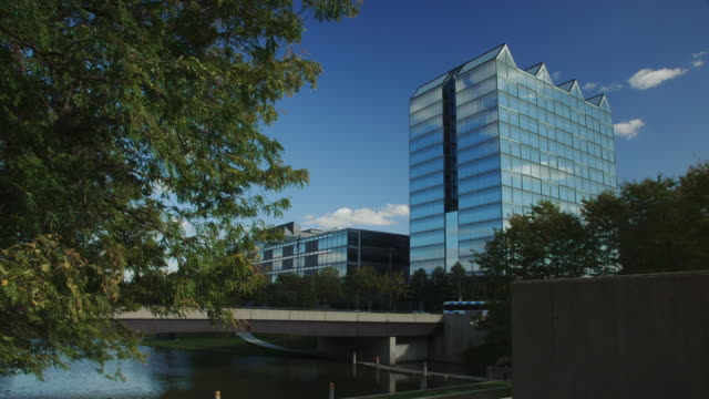 Timelapse of clouds behind a glass office building Gene Leahy Mall