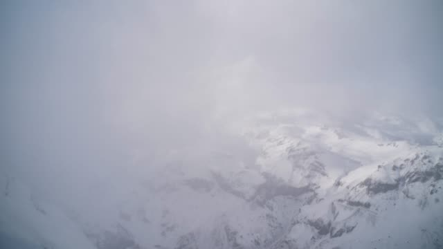 timelapse of clouds clearing revealing mount elbrus in russia - snowcapped mountain stock videos & royalty-free footage