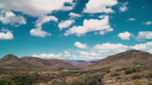 time-lapse of clouds in arid semi desert - the karoo stock videos & royalty-free footage