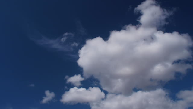 timelapse of clouds moving across the sky. - moody sky stock videos & royalty-free footage