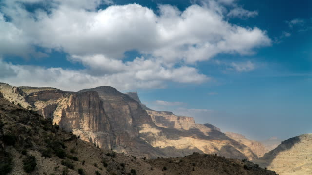 timelapse of clouds moving over canyon - canyon stock videos & royalty-free footage