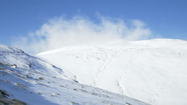 timelapse of clouds moving over mt kosciuszko peak - snow stock videos & royalty-free footage