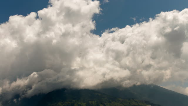 time-lapse of clouds moving over the summit of tungurahua volcano in ecuador - ecuador stock videos & royalty-free footage