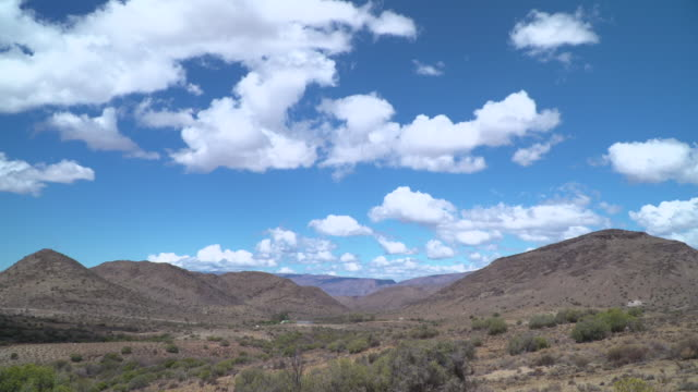 time-lapse of clouds over dry savannah scrubland - the karoo stock videos & royalty-free footage