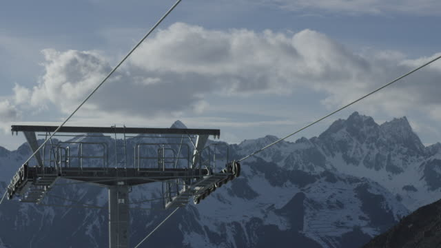 Timelapse of clouds over ski lift.