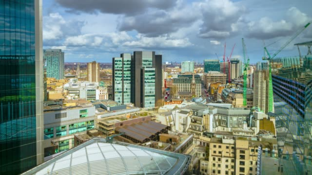 timelapse of clouds passing over london skyline with the view from city of london toward east end and whitechapel, london, united kingdom. - flat stock videos & royalty-free footage