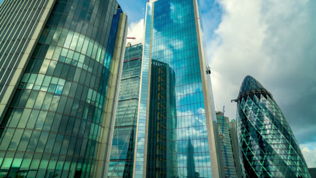 timelapse of clouds passing over skyscrapers the gherkin, the willis building, the leadenhall building and the scalpel in the city of london, london, united kingdom. - reflection stock videos & royalty-free footage