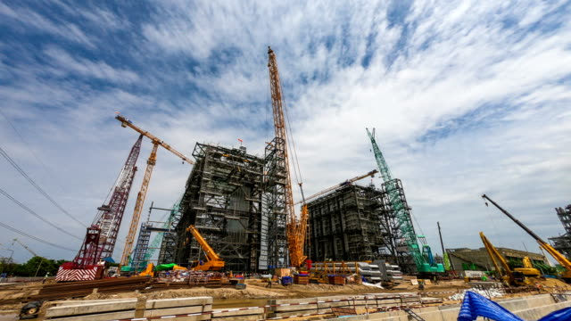 time-lapse of combine cycle power plant construction site with tower crane, mobile crane and steel structure of boiler and cooling tower - crane stock videos & royalty-free footage