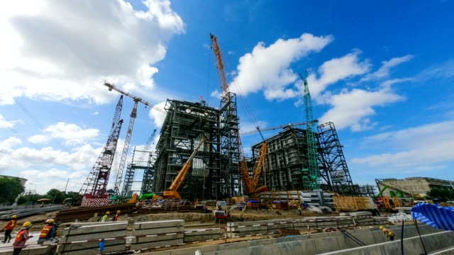 time-lapse of combine cycle power plant construction site with tower crane, mobile crane and steel structure of boiler and cooling tower - power station stock videos & royalty-free footage