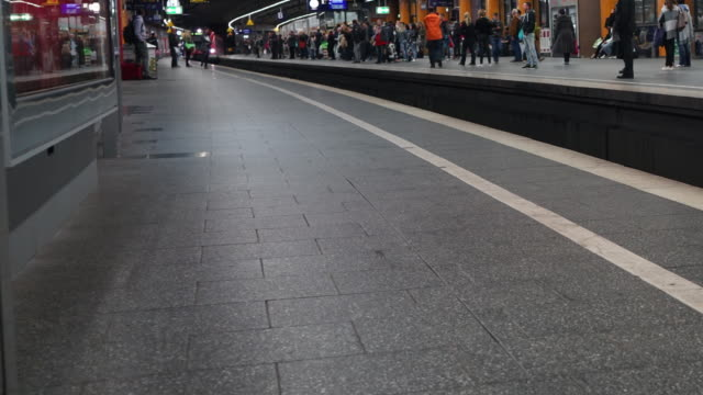 Time-lapse of commuter at railway station