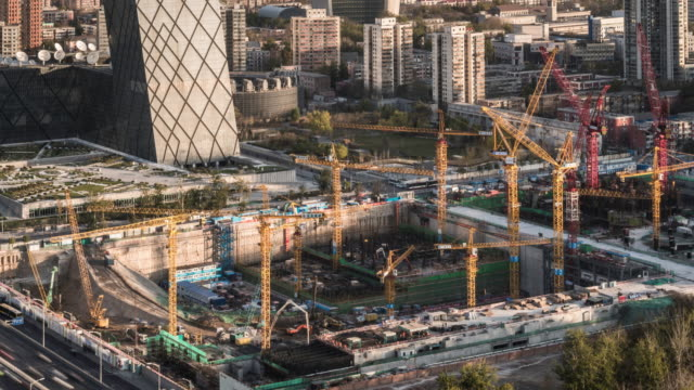 timelapse of construction site in front of ctv tower in beijing - construction industry stock videos & royalty-free footage