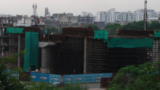 Time-Lapse of construction workers at the Rapid Metro Gurgaon, an offshoot of the Delhi Metro, construction site in NCR, India