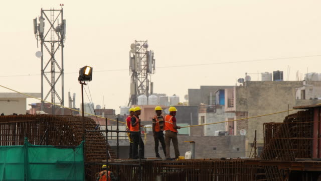 timelapse of construction workers on a rapid metro station site in gurgaond - newly industrialized country stock videos and b-roll footage