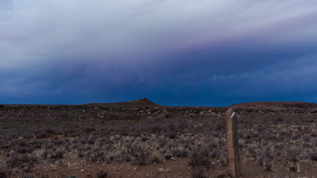 timelapse of dark stormy clouds rolling through the sky above a karoo landscape - karoo bildbanksvideor och videomaterial från bakom kulisserna