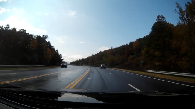 Timelapse, of dashcam shot of rainy day mountain road driving in America