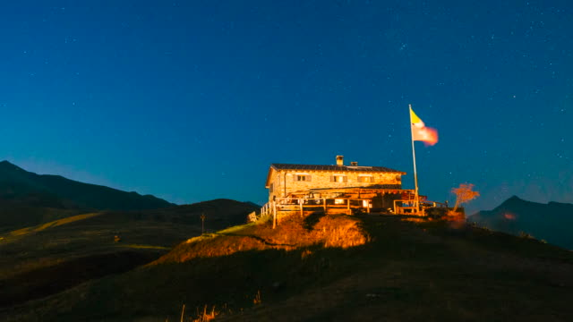 timelapse of day to night over mountain hut - capanna stock videos & royalty-free footage
