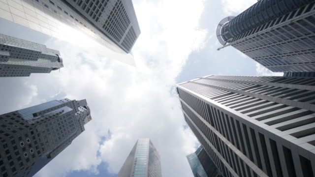 Timelapse of Directly below shot of skyscrapers against sky