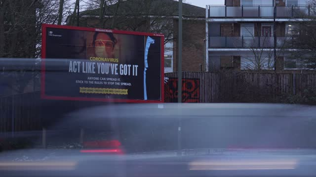 timelapse of 'don't help the virus spread' uk government warning advertising sign along the streets of north london london on february 09 in london... - video stock videos & royalty-free footage