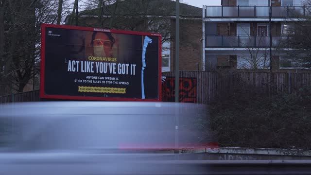 timelapse of 'don't help the virus spread' uk government warning advertising sign along the streets of north london london on february 09 in london... - danger stock videos & royalty-free footage