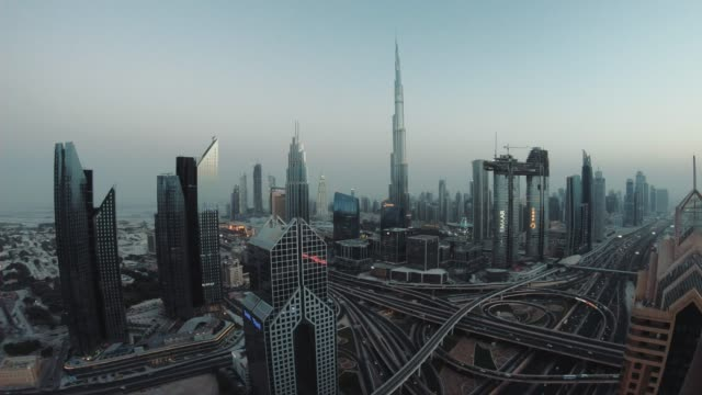 timelapse of dubai skyline during sunset blue hour - downtown stock videos & royalty-free footage
