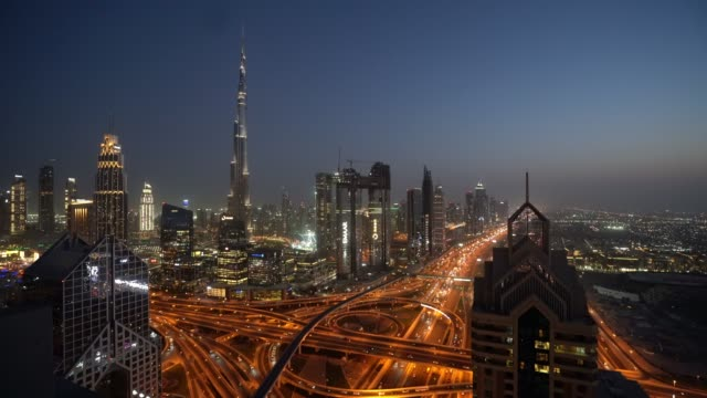 timelapse of dubai skyline during sunset blue hour - burj khalifa stock videos & royalty-free footage