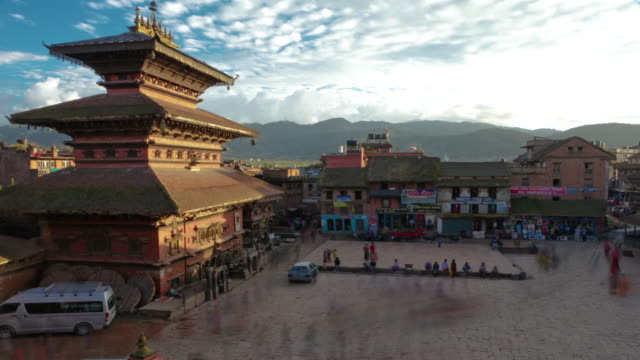 time-lapse of dusk at taumadhi square in bhaktapur, nepal. - public building stock videos and b-roll footage