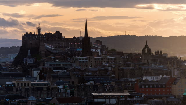 timelapse of edinburgh castle and city skyline - edinburgh scotland stock videos & royalty-free footage