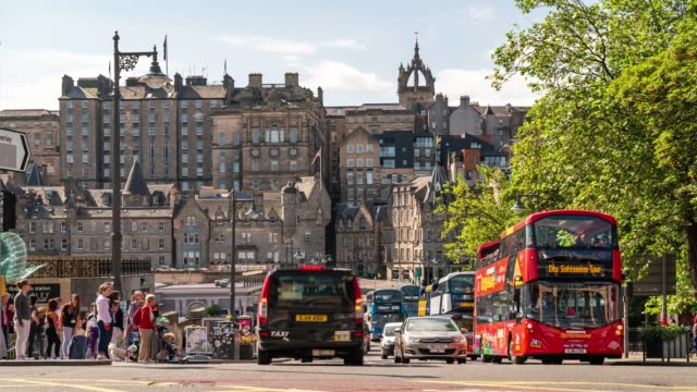 time-lapse of edinburgh old town in scotland uk - high street stock videos & royalty-free footage